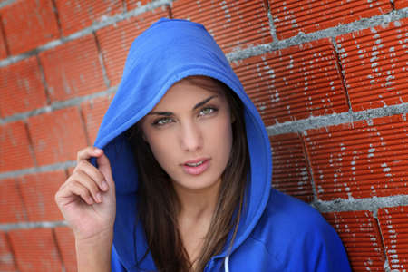hood: Portrait of teenager with blue sweater  Stock Photo