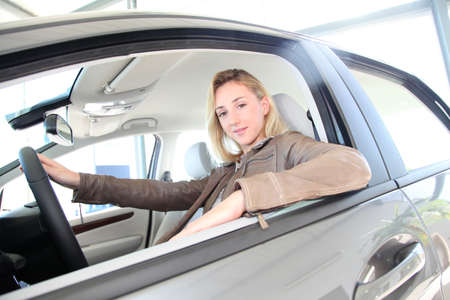 Woman sitting in brand new car Stock Photo - 10624595