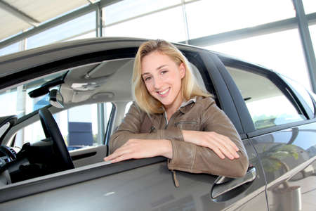 Woman sitting in brand new car Stock Photo - 10624633