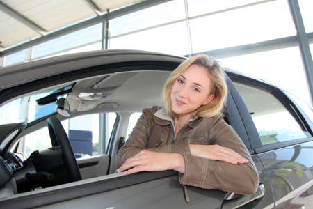 Woman sitting in brand new car Stock Photo - 10624587