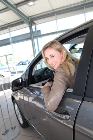 Woman sitting in brand new car Stock Photo - 10624670