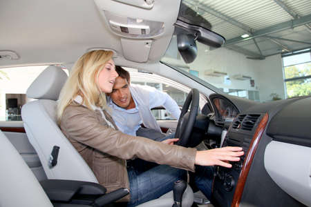 purchasers: Couple looking to buy a new car  Stock Photo