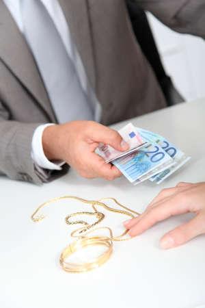 Gold against cash money photo