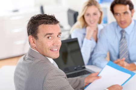 Couple with real-estate agent in office photo