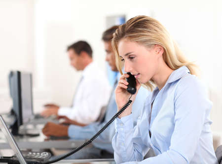 telephone saleswoman: Office worker answering the phone