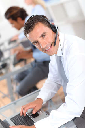 callcenter: Portrait of businessman with headset