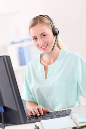 medicalcare: Portrait of nurse with headset