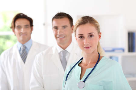 Medical team standing in clinic room photo
