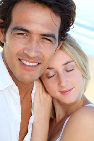 man woman hugging: Happy couple in holidays at the beach