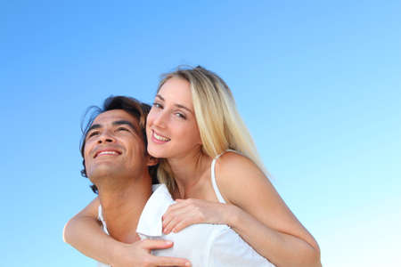 Smiling couple at the beach in summer Stock Photo - 10626273
