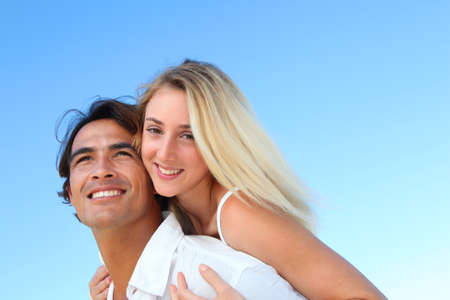 Smiling couple at the beach in summer Stock Photo - 10626214