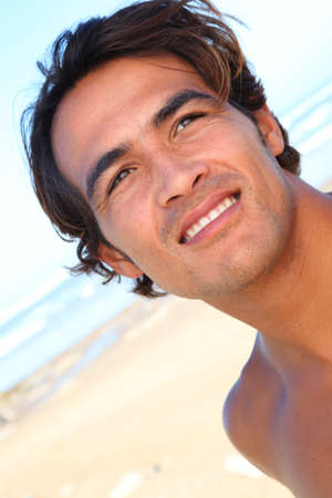 latin man: Portrait of handsome guy at the beach