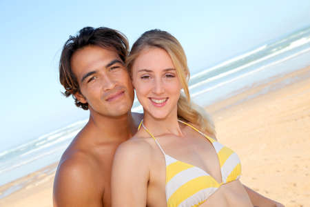 man woman hugging: Young couple having fun at the beach