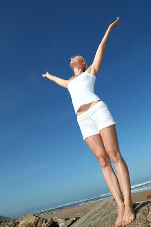 Woman stretching arms up from freedom Stock Photo - 10626242