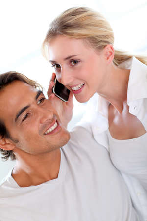 Couple receiving a phonecall photo