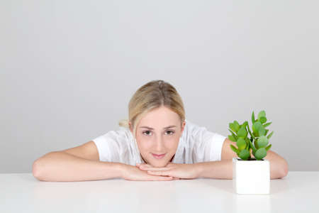 imaginative: Woman and natural plants set on table Stock Photo
