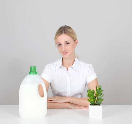 Woman presenting organic laundry detergent photo