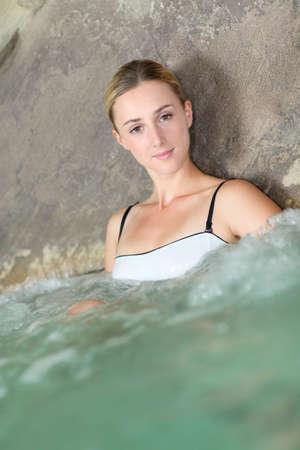 Portrait of beautiful woman in spa treatment photo