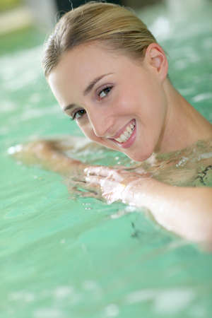 Portrait of beautiful woman in spa water photo