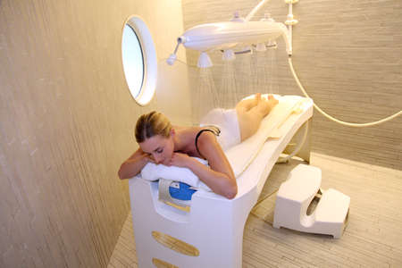 woman laying: Woman laying down table for spa treatment