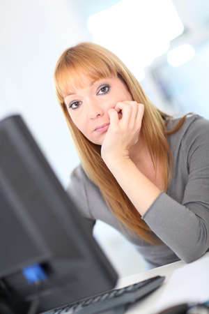 bored woman: Bored woman at work Stock Photo