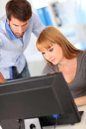 Business people working on desktop computer Stock Photo - 10773040