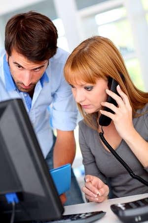 desktop computer: Business people working on desktop computer Stock Photo