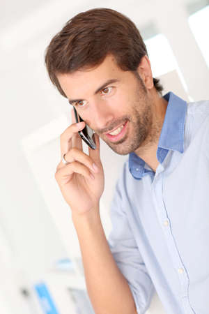 telephone salesman: Man talking on mobile phone