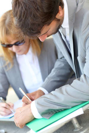 Business people signing contract photo