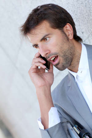telephone salesman: Portrait of salesman talking on mobile phone Stock Photo