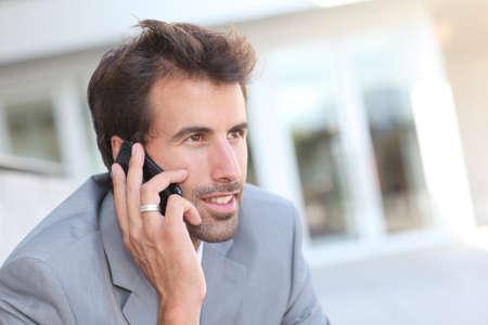 telephone salesman: Portrait of businessman talking on the phone Stock Photo