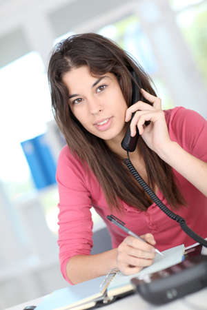 answering phone: Office worker talking on the phone