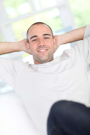shaved: Handsome guy relaxing in sofa Stock Photo