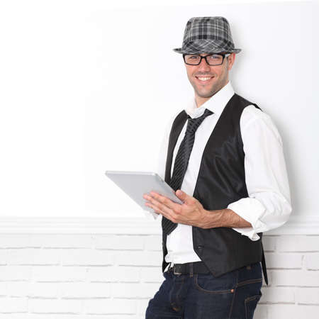 Smiling funny guy using electronic tablet Stock Photo - 10772844