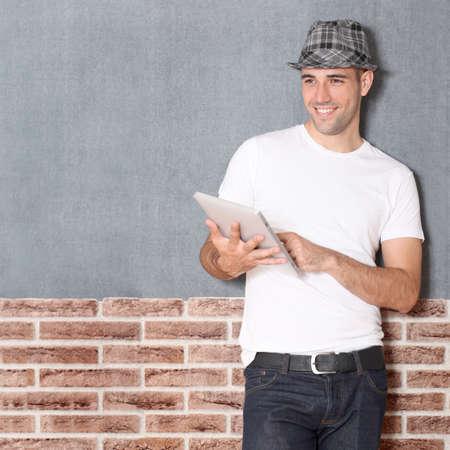 stylish boy: Stylish guy using electronic tablet