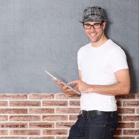 Stylish guy using electronic tablet photo