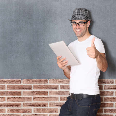 Stylish guy using electronic tablet Stock Photo - 10772258