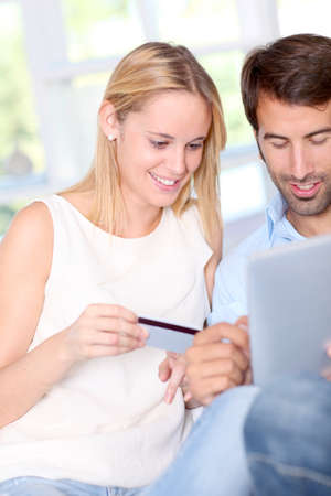 Young couple at home doing online shopping Stock Photo - 10797947