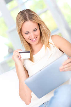 secured payment: Young woman doing online shopping