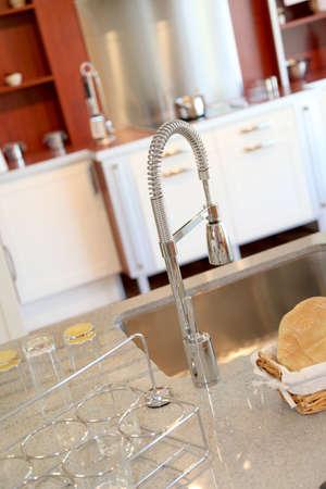 Closeup on kitchen faucet photo
