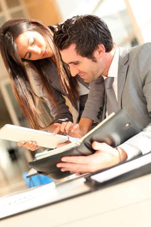 Business team checking planning on agenda Stock Photo - 10978957