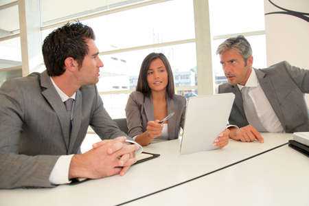 Business meeting with electronic tablet photo