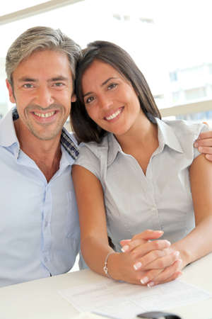 Portrait of father and girl in real-estate agency photo