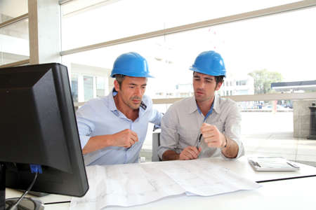 construction plans: Architects working on construction plan