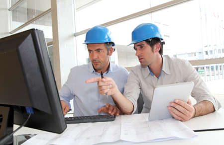 engineering: Architects working on construction plan