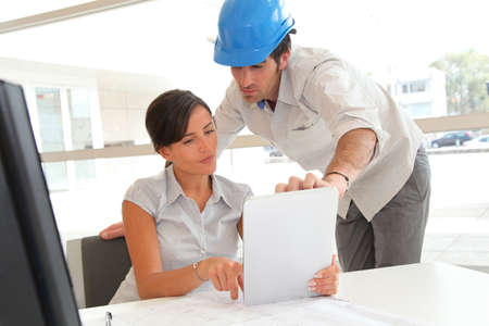 woman engineer: Architects working in office with electronic tablet