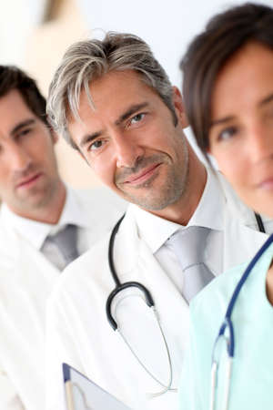 Portrait of doctor standing amongst medical team Stock Photo - 10978869