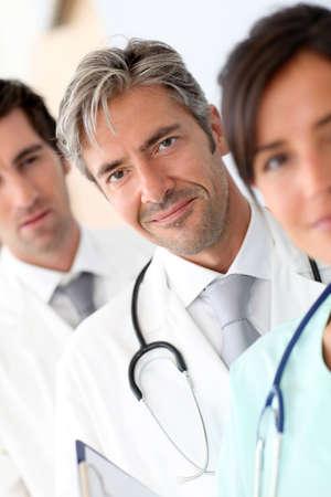 amongst: Portrait of doctor standing amongst medical team