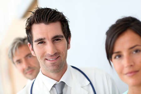Portrait of doctor standing amongst medical team Stock Photo - 10978881