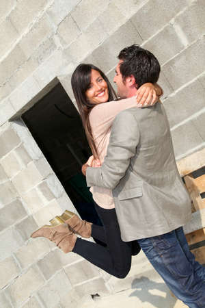 Cheerful couple in front of their house under construction Stock Photo - 10979191